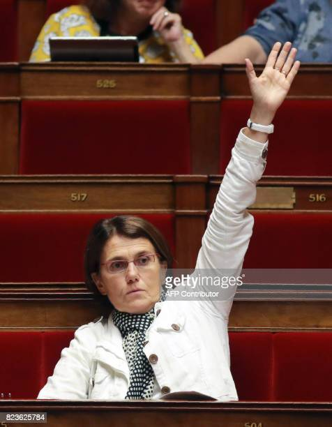 French left wing Nouvelle Gauche parliamentary group member of Parliament Laurence Dumont votes an amendment during a debate on a draft law on the...