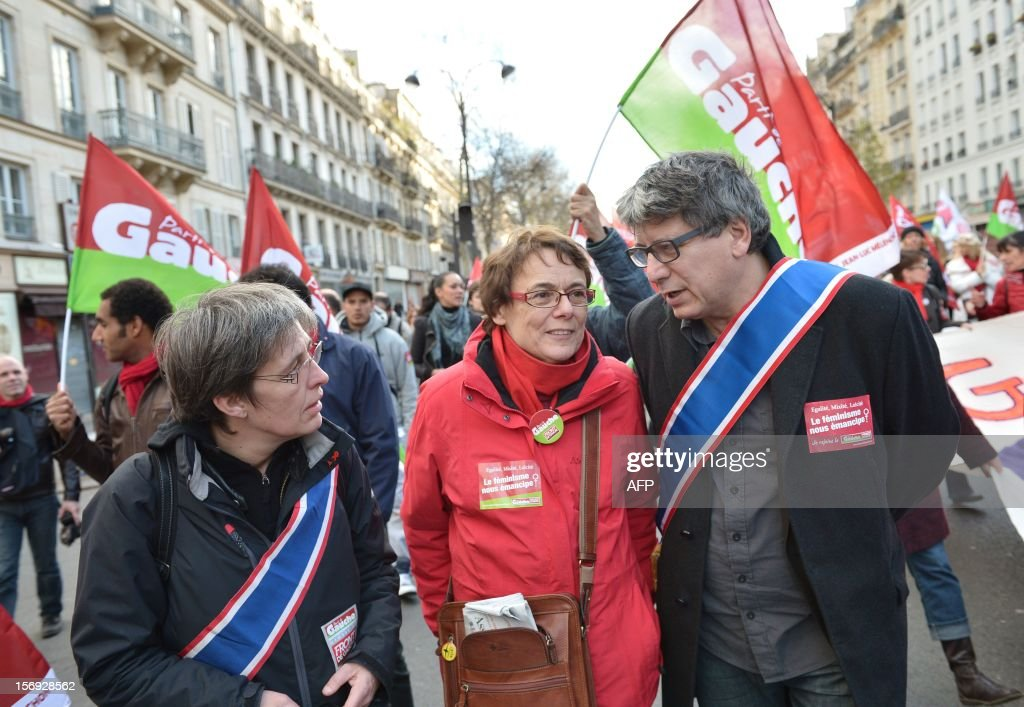 French leftist party Front de Gauche's (FG) vice-president Martine Billard (C), and Mars - Gauche republicaine (Republican and social alternative movement), a movement affiliated to Front de Gauche, president Eric Coquerel (R) take part in a demonstration called by the Women rights national collective, on November 25, 2012 in Paris, as part of the International Day for the Elimination of Violence Against Women. Since 1999, the United Nations each year invites governments, international organizations and NGOs to organize activities designed to encourage the public to fight such violence.