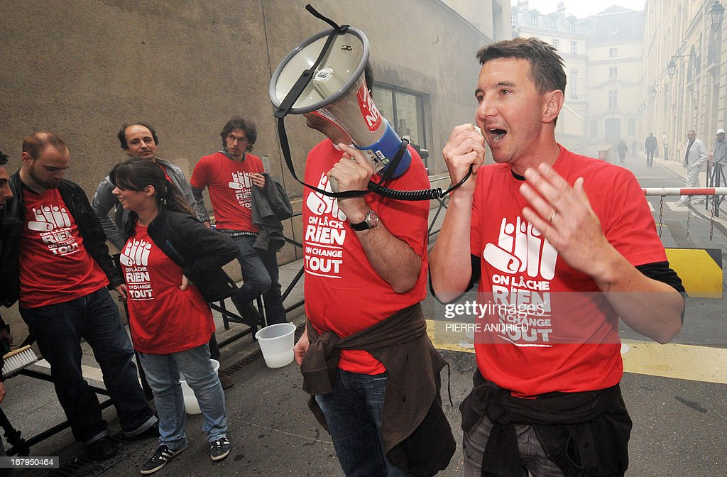 French leftist party NPA leader Olivier Besancenot (R) and some 20 other militants demonstrate near the Banque de France (Bank of France) headquarters on May 3, 2013 in Paris, to protest against the government as 'official sponsor of tax havens.'