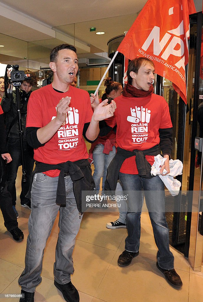 French leftist party NPA leader Olivier Besancenot (C) and some 20 other militants demonstrate in the lobby of the Banque de France (Bank of France) headquarters on May 3, 2013 in Paris, to protest against the government as 'official sponsor of tax havens.'