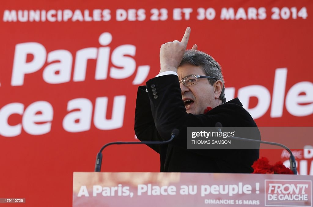 French leftwing party 'Parti de Gauche' coPresident JeanLuc Melenchon delivers a speech during a campaign meeting on March 16 2014 in Paris to...