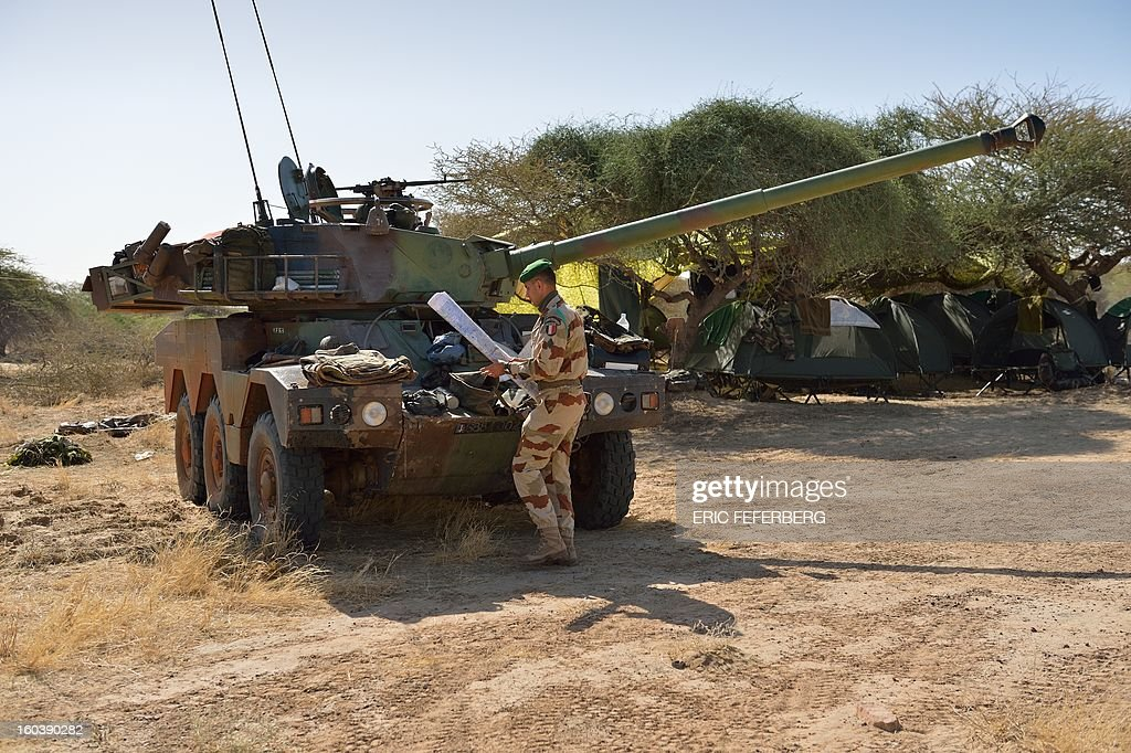 A French legionnaire works next to a Sagaie tank on January 30, 2013 at Timbuktu airport two days after French-led forces recaptured the northern Malian desert city. French troops on January 30 entered Kidal, the last Islamist bastion in Mali's north after a whirlwind Paris-led offensive, as France urged peace talks to douse ethnic tensions targeting Arabs and Tuaregs.