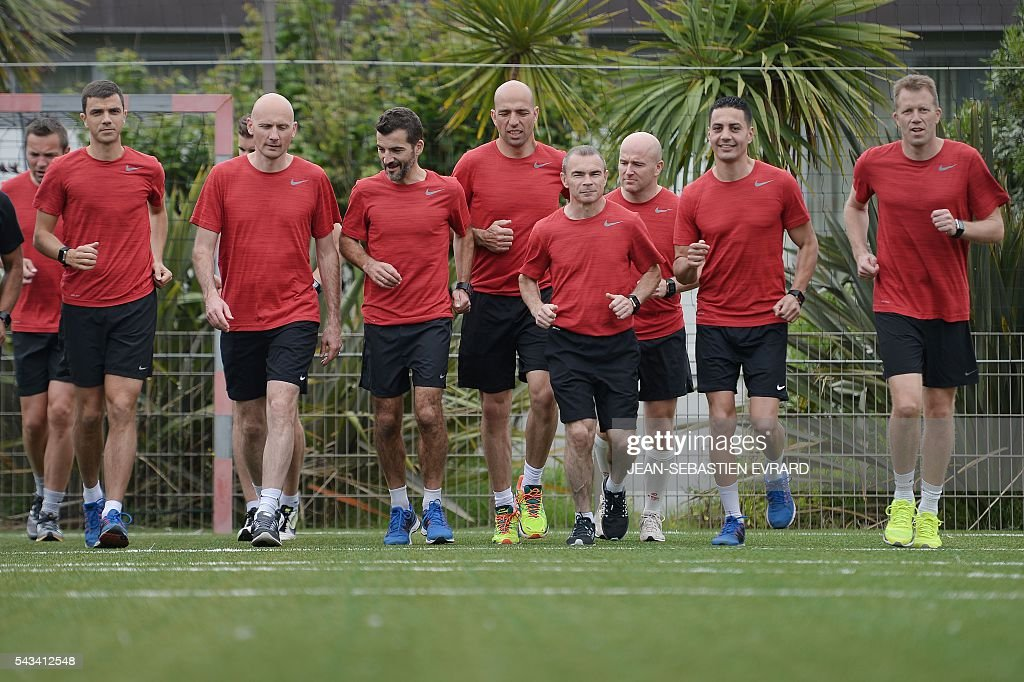 French Ligue 1 football referees take part in a training camp in Quiberon, western France, on June 28, 2016, ahead of the 2016/2017 French L1 football season. The French Ligue 1 football season will start on August 12, 2016. / AFP / JEAN
