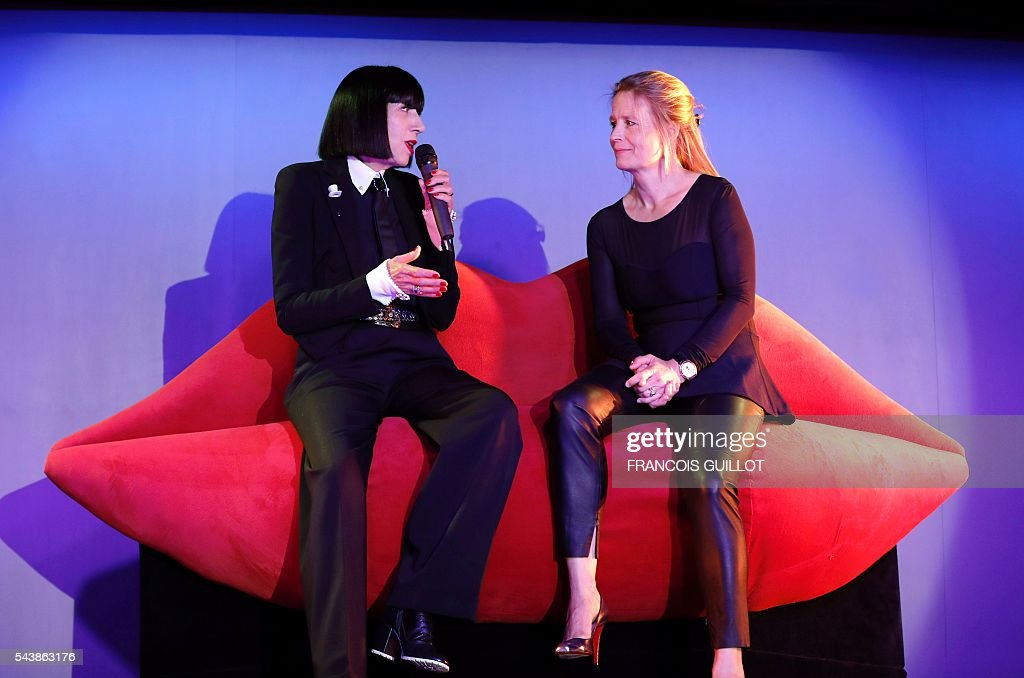 French lingerie designer Chantal Thomass (L), new guest artistic director of the Crazy Horse Paris show, talks during a press conference in Paris with the show's creation and development general director Andree Deissenberg, on June 30, 2016. Thomass has created the costumes and sets for a new show called 'Dessous Dessus' that will run from October 5 to December 31, 2016. / AFP / FRANCOIS