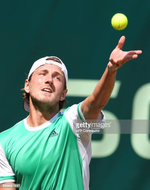 French Lucas Pouille in action against German Florian Mayer during the ATP tournament tennis match in Halle western Germany on June 22 2017 / AFP...