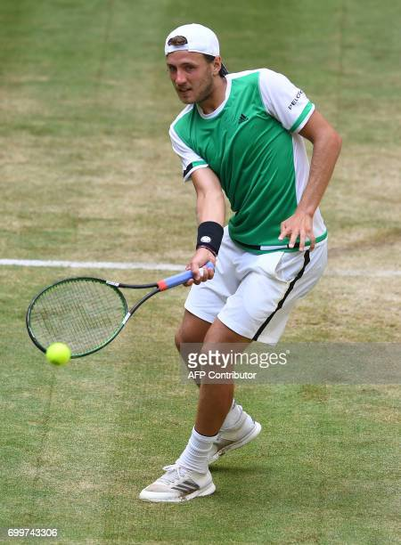 French Lucas Pouille plays against German Florian Mayer during the ATP tournament tennis match in Halle western Germany on June 22 2017 / AFP PHOTO /...