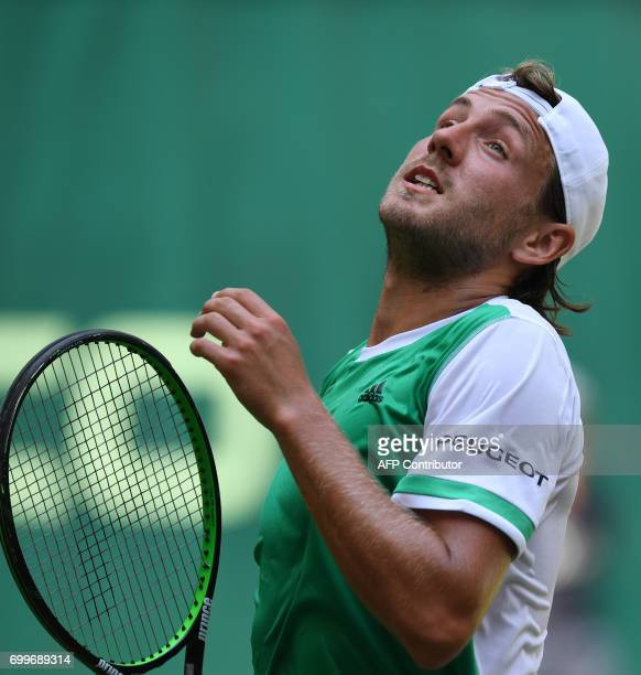 French Lucas Pouille reacts as he plays against German Florian Mayer during the ATP tournament tennis match in Halle western Germany on June 22 2017...