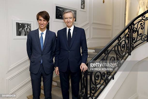 French luxury group LVMH Chairman and Chief Executive Officer Bernard Arnault and his son Alexandre pose before Christian Dior 20162017 fall/winter...