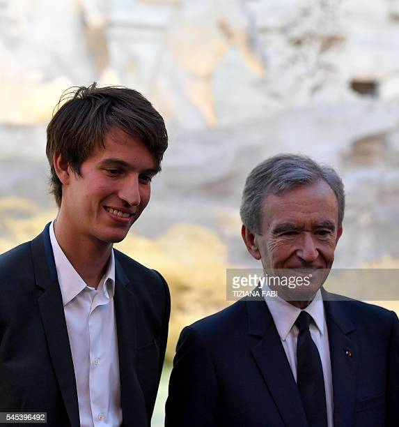 French luxury group LVMH Chairman and Chief Executive Officer Bernard Arnault and his son Alexandre arrive at the fashion show of Fendi at the Trevi...