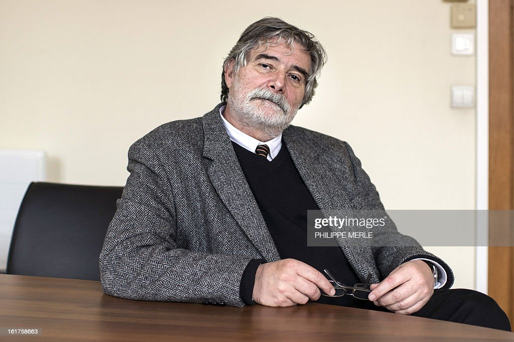 French Lyon 2 University President Jean-Luc Mayaud, poses on February 14, 2013, at his office, during an interview to express his deep concern towards French-Turkish student Sevil Sevimli situation a day before her trial. A Turkish court sentenced on February 15, the student to five years and two months in prison for 'terrorist propaganda', her lawyer said, adding she planned to appeal. MERLE