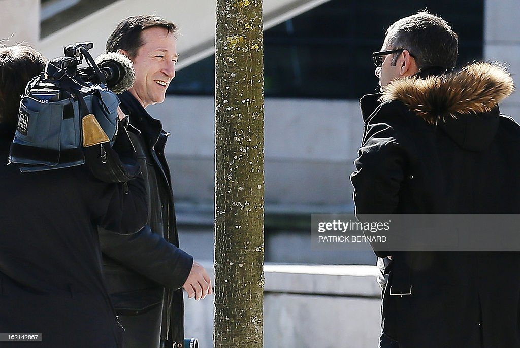 French magistrate Jean-Michel Gentil (2ndL), in charge of several judicial investigations linked to l'Oreal heiress Liliane Bettencourt's fortune, speaks with journalists as he arrives at the Bordeaux's courthouse on February 19, 2013.