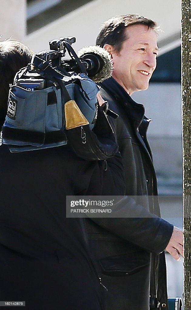 French magistrate Jean-Michel Gentil (R), in charge of several judicial investigations linked to l'Oreal heiress Liliane Bettencourt's fortune, speaks with journalists as he arrives at the Bordeaux's courthouse on February 19, 2013.