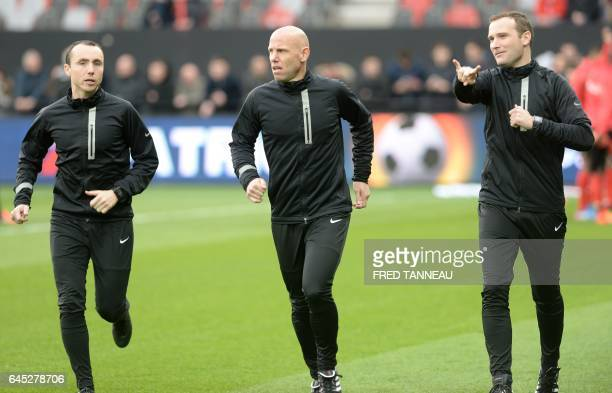 French main referee Amaury Delerue French assistant referees Bertrand Jouannaud and Cyril Mugnier warm up prior to the French L1 football match...