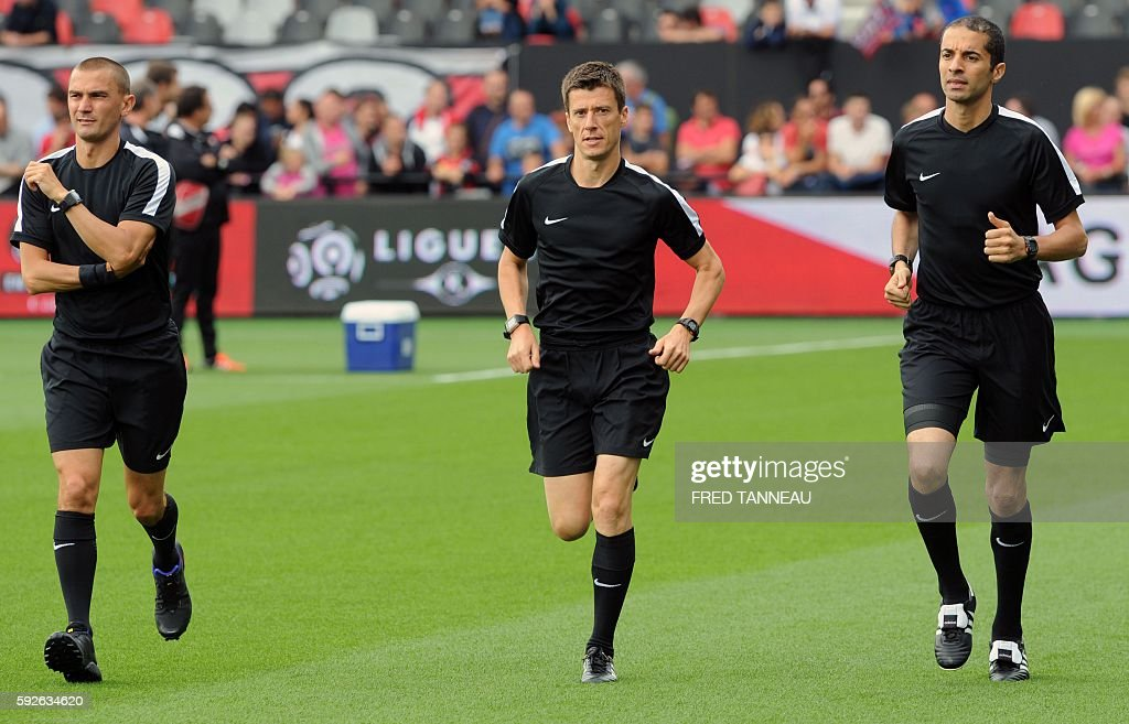 French main referee Benoit Bastien with assistant referres Frederic Haquette and Hicham Zakrani warm up prior to the French L1 football match between...