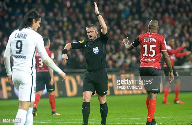 French main referee Fredy Fautrel gestures during the French L1 football match Guingamp against PSG on December 17 2016 at the Roudourou stadium in...