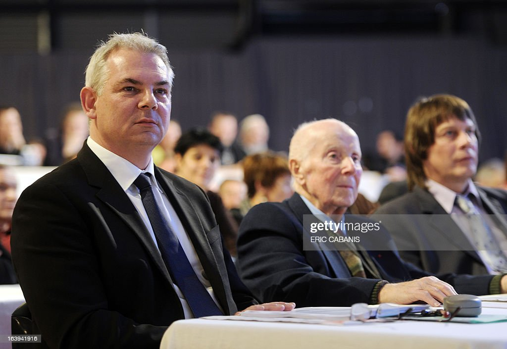 French major union CGT's general secretary from 1967 to 1982 Georges Seguy (C), sits next to his successors, outgoing leader Bernard Thibault (R) and newly designated Thierry Lepaon (G), on the first day of the CGT 50th congress on March 18, 2013 at Toulouse's exhibition center.