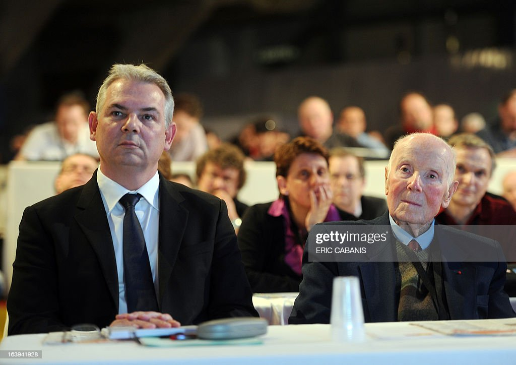 French major union CGT's general secretary from 1967 to 1982 Georges Seguy (R), sits next to his newly designated successor Thierry Lepaon (L), on the first day of the CGT 50th congress on March 18, 2013 at Toulouse's exhibition center.