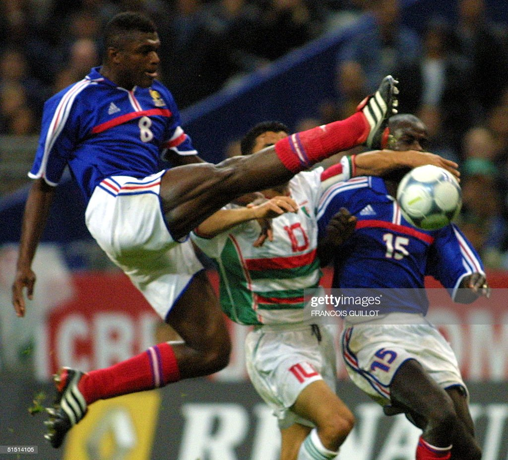 French Marcel Desailly C jumps for the ball duri
