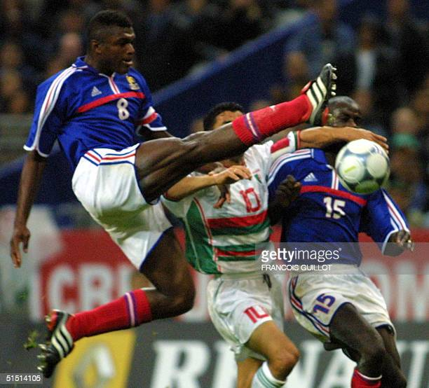 French Marcel Desailly jumps for the ball during the friendly soccer match France vs Algeria at the Stade de France in SaintDenis 06 October 2001 AFP...