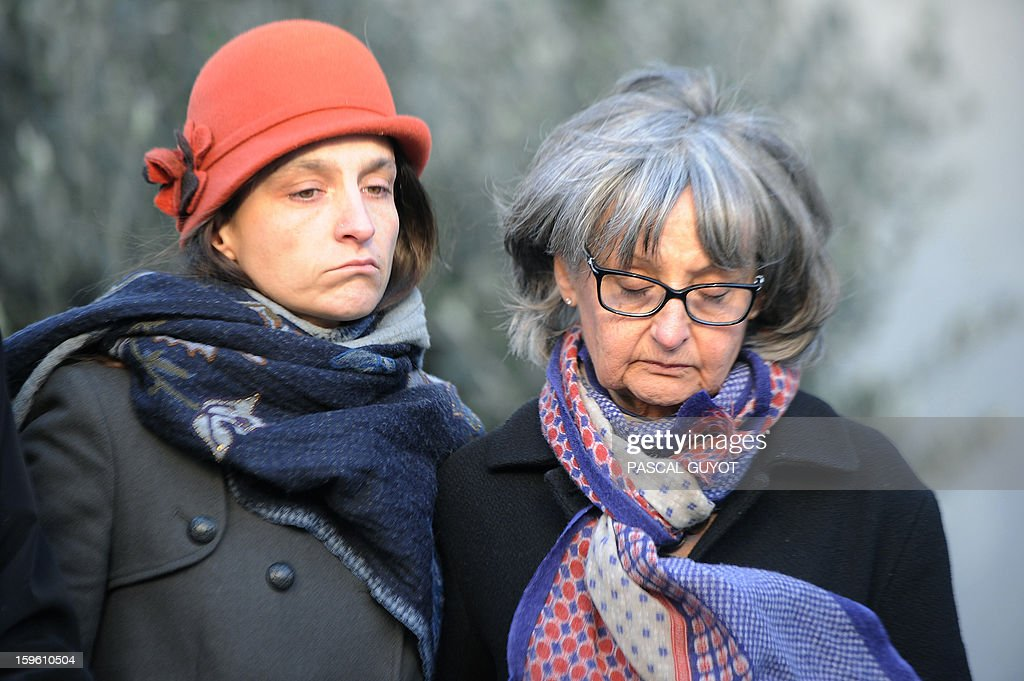 French Marion and Francoise Larribe, the daughter and the wife of Daniel Larribe, one of the four French hostages captured in Niger and detained since 28 months in Mali by AQIM, listen to speeches during a ceremony in support to hostages, on January 17, 2013 in Nimes, southern France. The four French hostages were in a group of seven captured in Niger's uranium-mining town of Arlit. The 'Serval' French military operation backing Mali's army in battling Islamist insurgents currently has some 1,400 soldiers deployed, some of whom are engaged in ground operations.