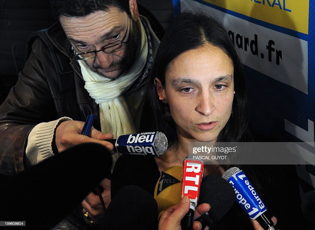 French Marion Larribe, daughter of Daniel Larribe, one of the four French hostages captured in Niger and detained since 28 months in Mali by AQIM, answers to journalists during a press conference, on January 17, 2013 in Nimes, southern France. The four French hostages were in a group of seven captured in Niger's uranium-mining town of Arlit. The 'Serval' French military operation backing Mali's army in battling Islamist insurgents currently has some 1,400 soldiers deployed, some of whom are engaged in ground operations.