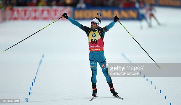 French Martin Fourcade celebrates in the finish of the men 10 km sprint at the Biathlon World Cup on January 13 in Ruhpolding southern Germany French...