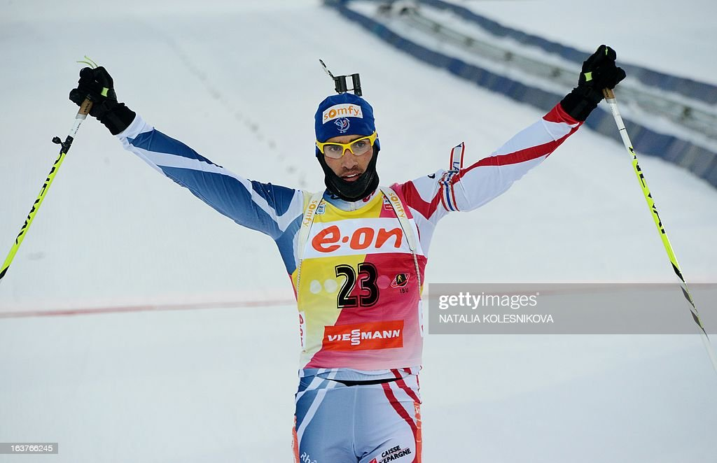 French Martin Fourcade reacts as he crosses the finish line during the men's 10 km sprint event of the IBU Biathlon Word Cup in the Siberian city of Khanty-Mansiysk, on March 15, 2013. AFP PHOTO/NATALIA KOLESNIKOVA