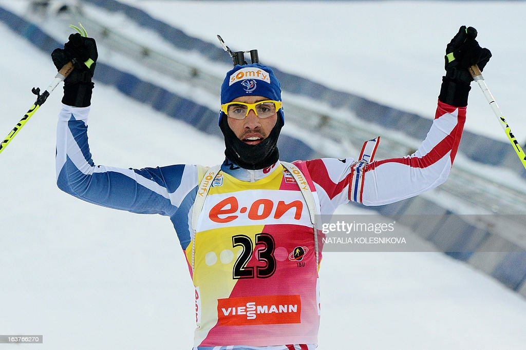 French Martin Fourcade reacts as he crosses the finish line during the men's 10 km sprint event of the IBU Biathlon Word Cup in the Siberian city of Khanty-Mansiysk, on March 15, 2013.