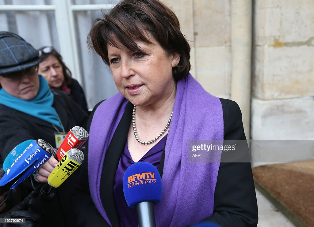French Martine Aubry, Lille's Mayor and former head of the French Socialist Party, answers to journalists on February 27, 2013 in the courtyard of the Hotel Matignon, the Prime minister official residence, as she pays homage to French Stephane Hessel. French Resistance fighter, diplomat and author of the bestselling 'Time For Outrage !' (Indignez Vous !) Hessel has died overnight at the age of 95 AFP PHOTO THOMAS SAMSON