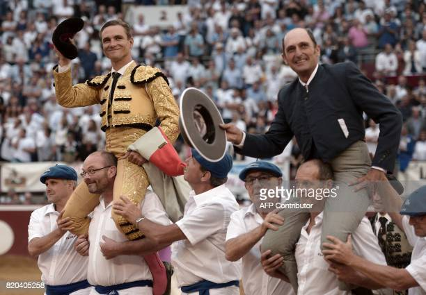 French matador Juan Bautista and La Quinta's mayoral gesture to the crowd at the end of a bullfighting event at Plumacon arena in MontdeMarsan...