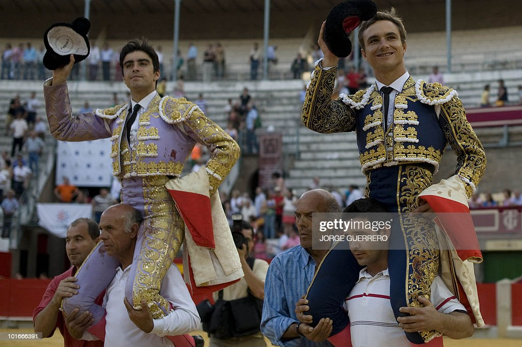 French matador Juan Bautista (R) and Spanish matador Miguel Angel Perera (L) are carried as they celebrate after a corrida at the Granada bullring on June 6, 2010 in Granada, southern Spain.