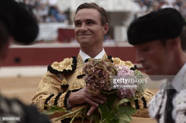 French matador Juan Bautista holds flowers at Plumacon arena in MontdeMarsan southwestern France during the festival of La Madeleine on July 21 2017...