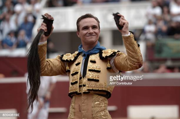 French matador Juan Bautista holds the tail and the two ears of a La Quinta bull at Plumacon arena in MontdeMarsan southwestern France during the...
