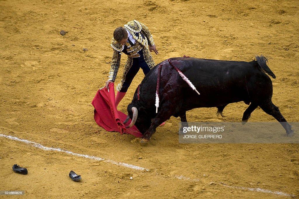 French matador Juan Bautista makes a pass to a bull during a corrida at the Granada bullring on June 6, 2010 in Granada, southern Spain.