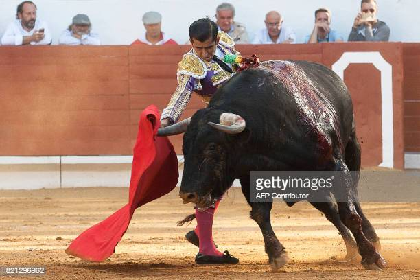 French matador Juan Bautista performs a pass in SaintVincentdeTyrosse on July 23 2017 / AFP PHOTO / Daniel VELEZ