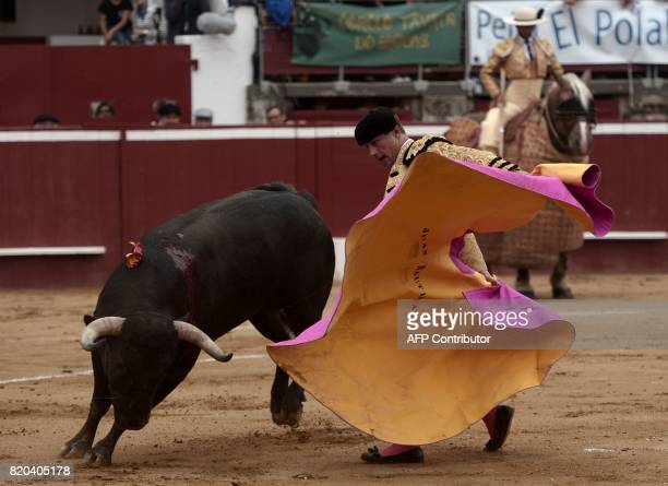 French matador Juan Bautista performs a pass on a La Quinta bull at Plumacon arena in MontdeMarsan southwestern France during the festival of La...