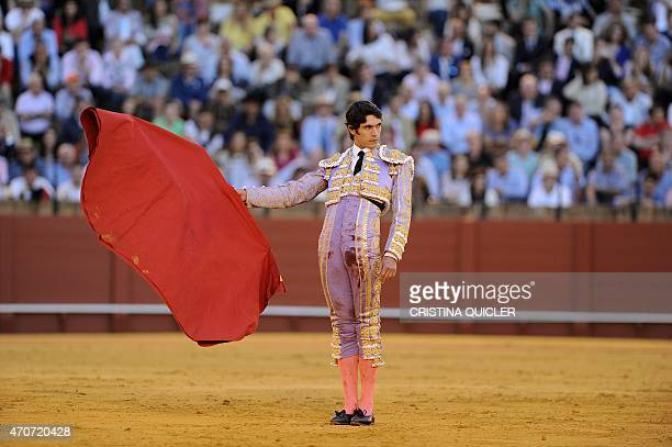 French matador Sebastian Castella holds the 'muleta' as he waits for the bull to charge during a bullfight at the Maestranza bullring in Sevilla on...