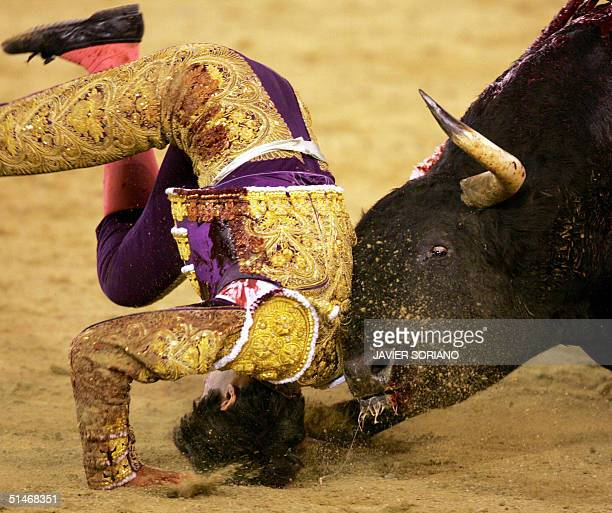French 'matador' Sebastian Castella is hooked by his second bull 11 October 2004 during a 'corrida' at Las Ventas Bullring in Madrid AFP PHOTO/...