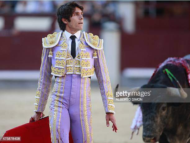 French matador Sebastian Castella looks at the spectators as he fights a bull during the San Isidro Feria at Las Ventas bullring in Madrid on June 4...