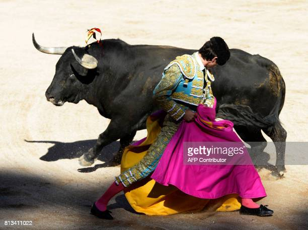 TOPSHOT French matador Sebastian Castella performs a pass on a Victoriano del Rio Cortes' fighting bull during the sixth bullfight of the San Fermin...