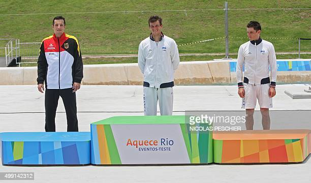 French Mathieu Biazizzo German Sebastien Schubert and French Sebastien Combot prepare to step on the podium after winning the first second and third...