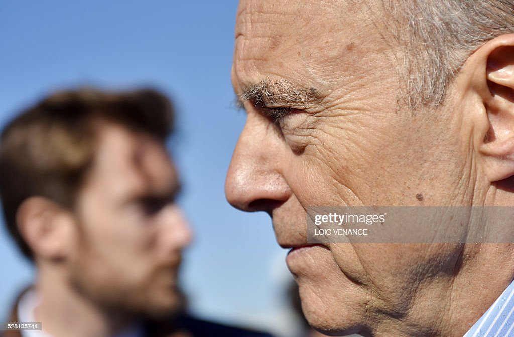 French mayor of Bordeaux and candidate for the right-wing Les Republicains (The Republicans) presidential primary Alain Juppe talks to journalists during a visit to Saint-Gilles-Croix-de-Vie, western France, on May 4, 2016. / AFP / LOIC