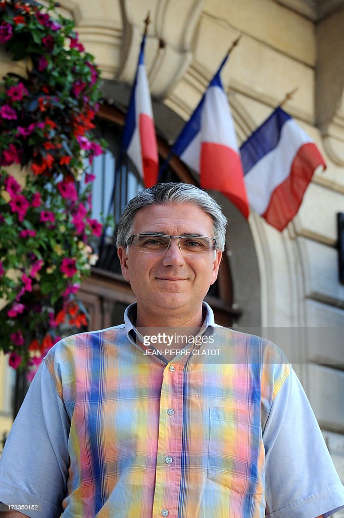 French Mayor of Saint-Jean-de-Maurienne Pierre-Marie Charvoz, poses for a photograph on July 12, 2013 after speaking with a journalist about the take over of the Rio Tinto Alcan (RTA) aluminium factory by Germany's group Trimet. Heads of Rio Tinto Alcan and Trimet met today in Paris regarding the take over of RTA by Trimet which could save 510 jobs at the two sites of Saint-Jean-de-Maurienne and Castelsarrasin.