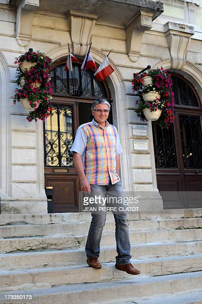 French Mayor of SaintJeandeMaurienne PierreMarie Charvoz poses for a photograph on July 12 2013 after speaking with a journalist about the take over...