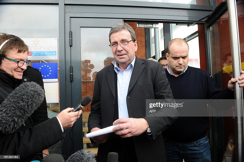 French meat supplier Spanghero's president, Barthelemy Aguerre (C), answers journalists questions on February 11, 2013 at the headquarters of Spanghero in Castelnaudary, southern France. The Europe-wide scandal over horsemeat sold as beef spread on February 10 as leading French retailers pulled products from their shelves and threats of legal action flew. The suspect lasagne meals sold by Swedish frozen food giant Findus in Britain were made by French company Comigel using meat supplied by French meat-processing firm Spanghero. Aguerre declared that Spanghero respected the law.