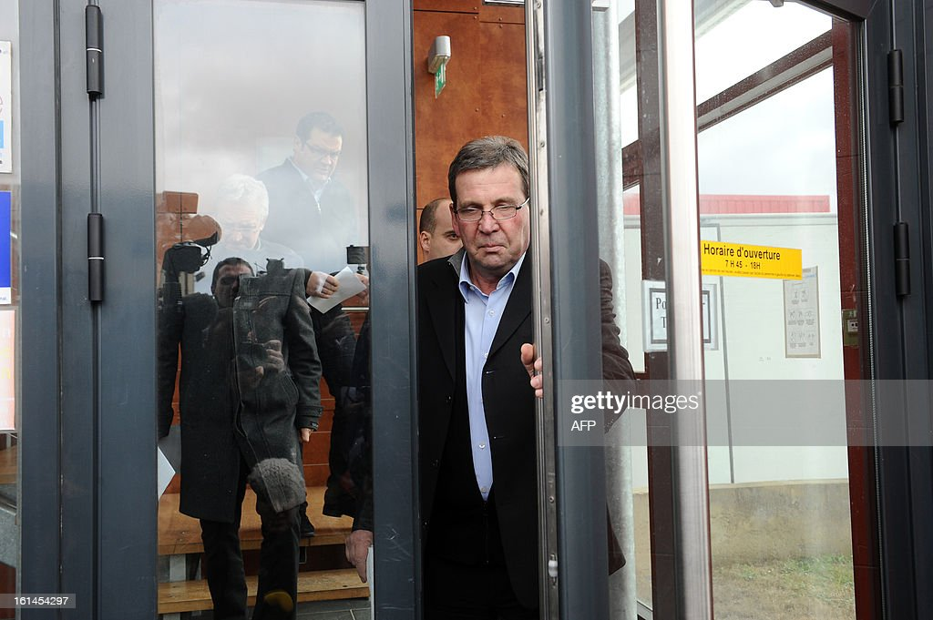 French meat supplier Spanghero's president, Barthelemy Aguerre (C), arrives to speak to journalists on February 11, 2013 at the headquarters of Spanghero in Castelnaudary, southern France. The Europe-wide scandal over horsemeat sold as beef spread on February 10 as leading French retailers pulled products from their shelves and threats of legal action flew. The suspect lasagne meals sold by Swedish frozen food giant Findus in Britain were made by French company Comigel using meat supplied by French meat-processing firm Spanghero. Aguerre declared that Spanghero respected the law.