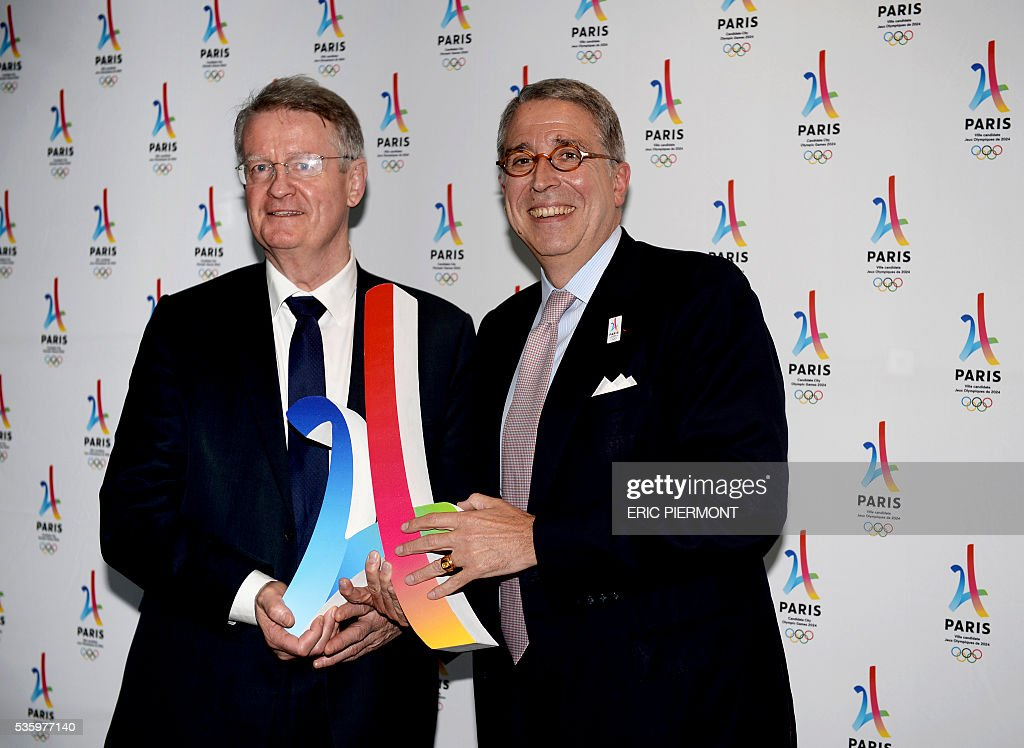 French media group Vivendi chairman of the management board Arnaud de Puyfontaine (R) poses with co-chairman of the Paris 2024 Olympic and Paralympic Games bid Bernard Lapasset (L) prior to attend a meeting gathering French companies and official partners of Paris candidate for the 2024 Summer Olympic games on May 30, 2016 in Paris. / AFP / ERIC