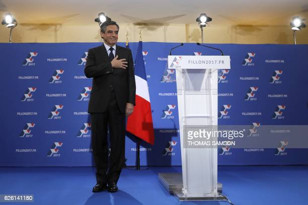 TOPSHOT French member of Parliament and candidate for the rightwing primaries ahead of France's 2017 presidential elections Francois Fillon gestures...