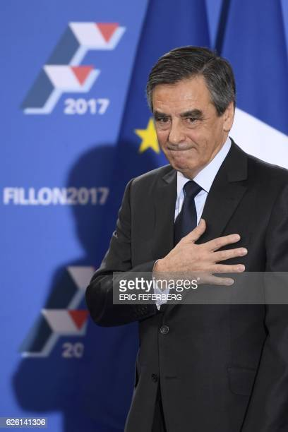 French member of Parliament and candidate for the rightwing primaries ahead of France's 2017 presidential elections Francois Fillon gestures before...