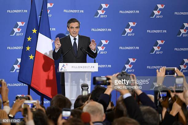 French member of Parliament and candidate for the rightwing primaries ahead of France's 2017 presidential elections Francois Fillon gestures as he...